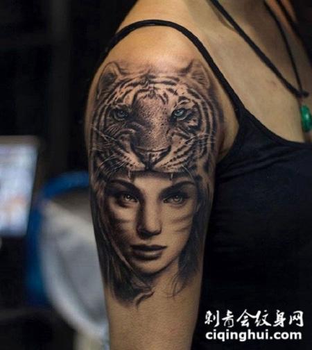 手臂上的虎女纹身图案