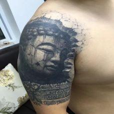 我佛慈悲,手臂d石裂佛像纹身
