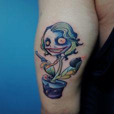 疯狂的化身,手臂个性鲜明的卡通小丑纹身图案