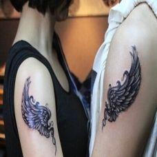 手臂翅膀个性情侣纹身图案