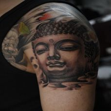 小臂胳膊佛头纹身图案立体感十足