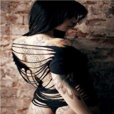 非主流时尚美女手臂纹身图片