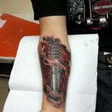 手臂个性金属兵器纹身图案