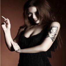 性感尤物手臂纹身图片