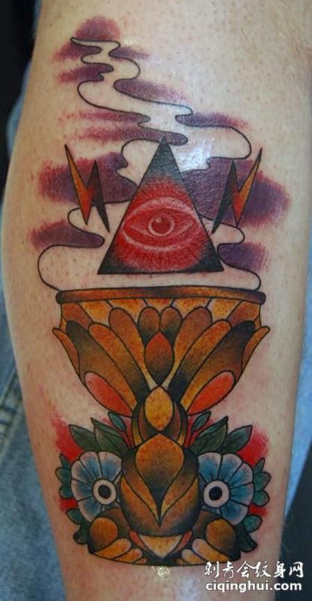 小臂上的猫头鹰烛台纹身图案