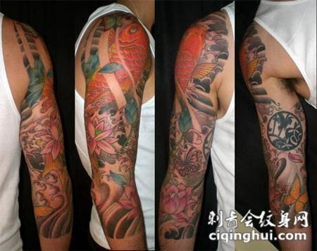 大臂上的鲤鱼莲花纹身图案