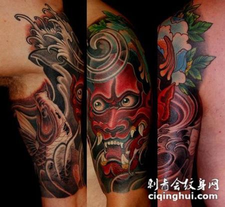 大臂上的般若鲤鱼纹身图案