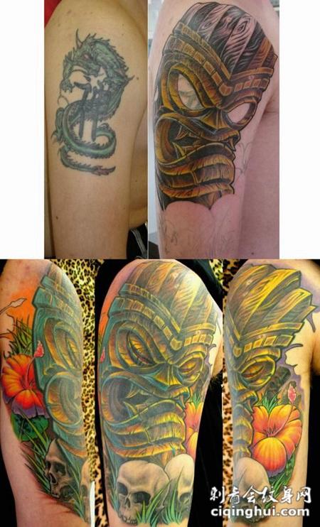 大臂上的守护神木雕纹身图案