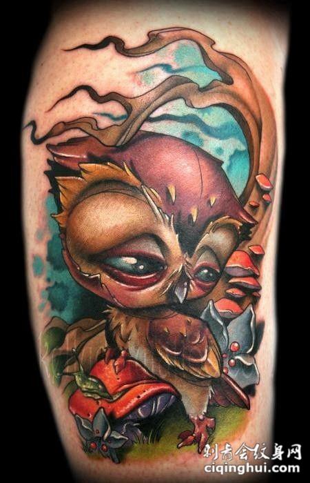 大臂上的猫头鹰纹身图案