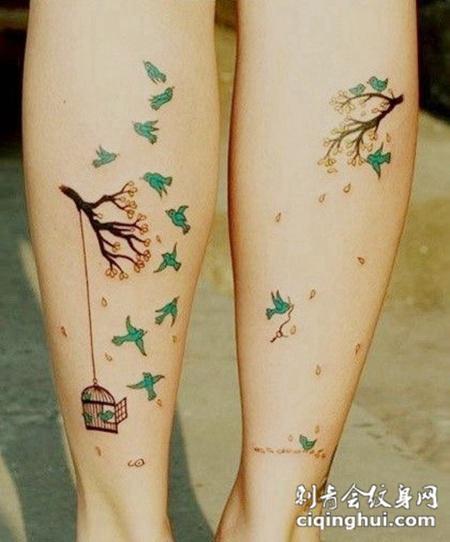 小腿上的树枝鸟笼子纹身图案