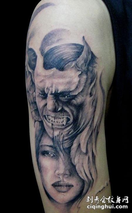 胳膊上的恶魔美女纹身图片