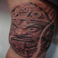 胳膊上的石刻罗汉纹身