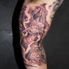 胳膊上的死神恶魔纹身图案