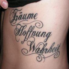 腰侧的英文单词纹身图案