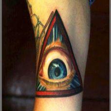 小腿上的三角眼睛纹身图案