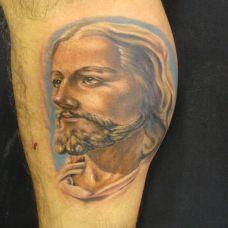 小腿上的耶稣纹身图案