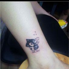 小腿上吹蒲公英的猫纹身图案