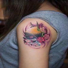 胳膊上的deadgirl纹身图案