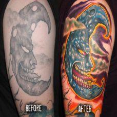 大臂上的修改恶魔月亮纹身图案