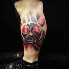 小腿上的防毒面具纹身图案