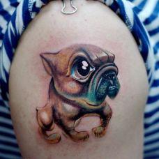 大臂上的斗犬小狗纹身图案