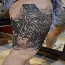 大腿上的阎王纹身图案
