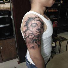佛法无边,手臂3d石裂风格佛像纹身