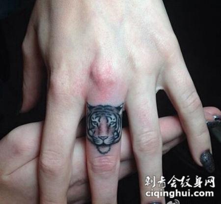 凶猛手指老虎头像纹身图案