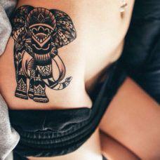 女人性感腰部黑色大象图腾纹身图案