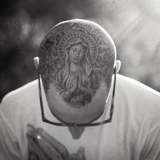 虔诚圣母玛利亚脸部纹身