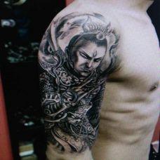 手臂黑色二郎神经典纹身图片