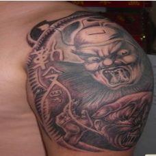 男生霸气钟馗手臂纹身图案