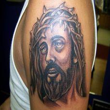 胳膊帅气的耶稣头像纹身图案