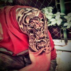 男孩个性手臂经典二郎神纹身图案