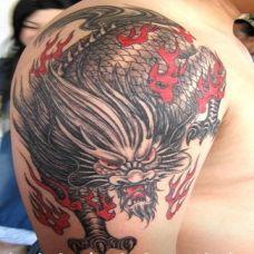 霸气男胳膊纹身图片 火麒麟系列图案