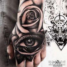 写实手背眼睛玫瑰纹身图案