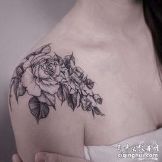 点刺大臂玫瑰纹身图案