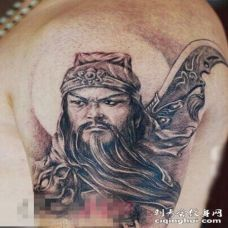 勇猛威武的黑色点刺抽象线条人物肖像关公纹身图案