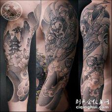 手臂黑色斗战胜佛与寺庙纹身图案