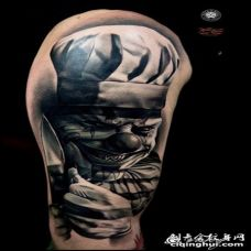 手臂3D疯狂的邪恶小丑和刀纹身图案