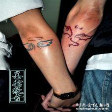 天使恶魔手臂纹身 天使恶魔心手臂纹身图片