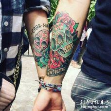 情侣手臂彩色骷髅头纹身图案