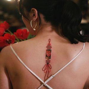 背部小清新牡丹花中国结纹身图案