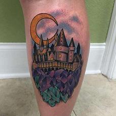大腿城堡和月亮纹身图案