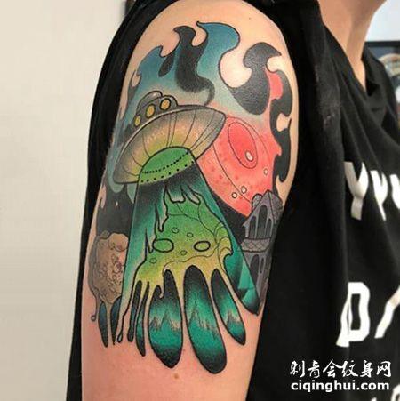 大臂飞碟纹身图片