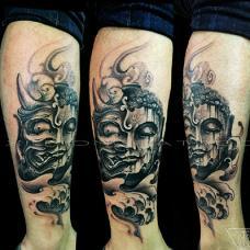 小腿上怪异黑色佛魔纹身图案