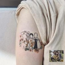 大臂家庭纹身图片