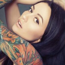 欧美女人花臂兰花纹身图案