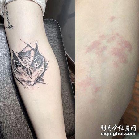 手臂猫头鹰图案红色胎记纹身