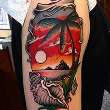 大臂海岛日出纹身图片